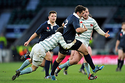Alexander Macdonald of Oxford University takes on the Cambridge defence - Photo mandatory by-line: Patrick Khachfe/JMP - Mobile: 07966 386802 11/12/2014 - SPORT - RUGBY UNION - London - Twickenham Stadium - Oxford University v Cambridge University - The Varsity Match