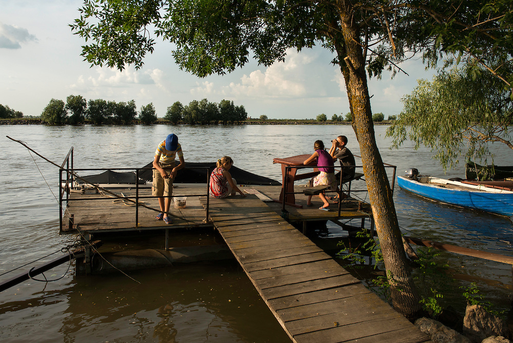 KIds playing down by the riverside, Crisan, Danube Delta, Romania.