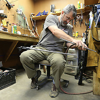Gunsmith Dale Butler, cleans his tools as he works on a custom barrel for a customers rifle. Butler has been with Richey's for 10 years.