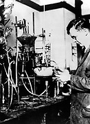 Wallace Hume Carothers (1896-1937) in the laboratory. Discovered of nylon while working for Dupont Company, 1927. American industrial chemist. Courtesy Du Pont Company