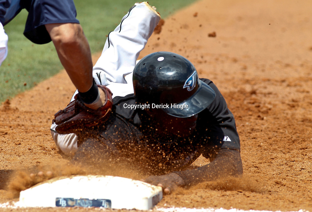 March 8, 2011; Port Charlotte, FL, USA; Toronto Blue Jays shortstop Adeiny Hechavarria (3) is tagged out by Tampa Bay Rays first baseman Casey Kotchman (23) during a spring training exhibition game at Charlotte Sports Park.  Mandatory Credit: Derick E. Hingle-US PRESSWIRE