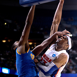 Mar 19, 2011; Tampa, FL, USA; UCLA Bruins guard Malcolm Lee (3) shoots over Florida Gators forward Alex Tyus (23) during second half of the third round of the 2011 NCAA men's basketball tournament at the St. Pete Times Forum. Florida defeated UCLA 73-65.  Mandatory Credit: Derick E. Hingle