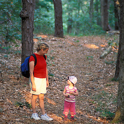 Harwich, MA..A woman and her daughter explore a trail in the oak-pine forest near the Monomoy River (a.k.a. Muddy Creek) in Harwich on Cape Cod.