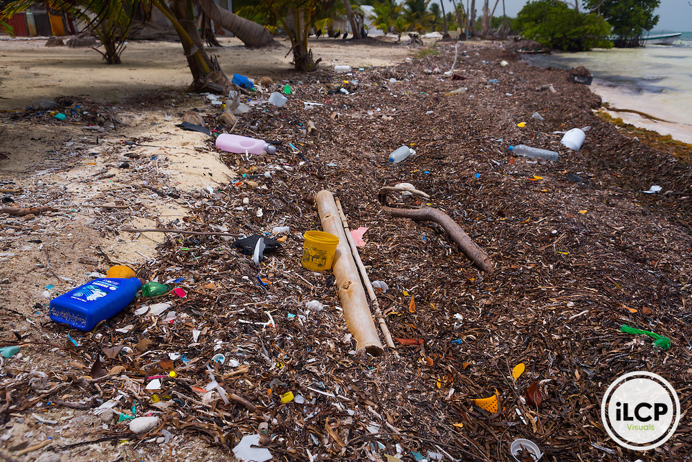 Plastic pollution on the shore in María Elena, a small, remote fishing camp in the Sian Ka'an Biosphere Reserve in southernmost Caribbean Mexico. All throughout the Caribbean plastic washes up and aggregates on the beach in dramatic quantities. This scene was not exceptional. From a 2014 iLCP (International League of Conservation Photographers) expedition project documenting the people and places of the Mexican section of the Mesoamerican Reef (MAR).