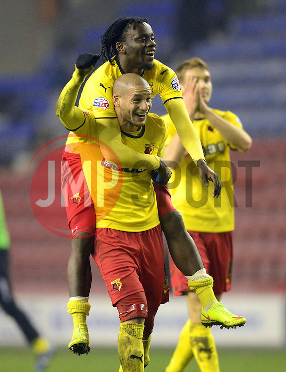 Watford's Adlene Guedioura and Juan Carlos Paredes celebrate at the end of the match- Photo mandatory by-line: Richard Martin-Roberts/JMP - Mobile: 07966 386802 - 17/03/2015 - SPORT - Football - Wigan - DW Stadium - Wigan Athletic  v Watford - Sky Bet Championship