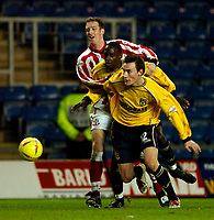Photo: Richard Lane.<br /> Oxford United v Lincoln City. Nationwide Division Three. 10/01/2004.<br /> Dean Whitehead and Mark Rawle break away from Simon Weaver.