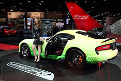 12 February 2015: 2015 DODGE VIPER: A major attraction in the Dodge exhibit during the 2015 Chicago Auto Show is the Dodge Viper. Visitors are among the first to view the new Viper GT edition that is priced between the Viper and Viper GTS models. The '15 Viper GT comes with driver-selectable suspension system and luxurious cockpit appointments that were previously only available with the top-tier GTS model price class. There are new interior color combinations for the Alcantara, Nappa leather and Laguna leather materials, including the all-new Demonic Red. Two new high-impact, show-car quality exterior colors are available for the 2015 GT and GTS models, Stryker Purple and Y'Orange. To further appoint the exterior are available stripes in Black Venom, Billet Silver, Bright White, Gunmetal Pearl and Adrenaline Red. There have been continuous refinements to the heart and soul of the Viper GTS, the 8.4-liter V-10 engine and Tremec six-speed manual transmission that have resulted in an additional five- horsepower – now 645 – and an additional mile per gallon (mpg) on the highway to 20 mpg. The exhaust system continues to exit forward of the rear wheels and carries further refinement with cast aluminum, sill-mounted exhaust bezels. Listening to consumers, Dodge revised the sixth gear ratio for the Dodge Viper models, resulting in reduced engine noise at highway cruising speeds. All '15 Dodge SRT Viper models carry LED tail lamps that integrate stop-and-turn illumination in one element. Snakeskin texture in the lens carries the surface work seen in the gills and hood textures. While at the Chicago show, Feb. 14-22, 2015, ask about the Viper TA (Time Attack) 2.0 Special Edition spec-package, which enhances the turn-key on-track set-up with more performance upgrades in three exclusive, limited-edition colors. Plus, there is new Dodge Viper GTS Ceramic Blue Edition Package with unique ceramic exterior paint color and a cabin outfitted with Alcantara and carbon fibe