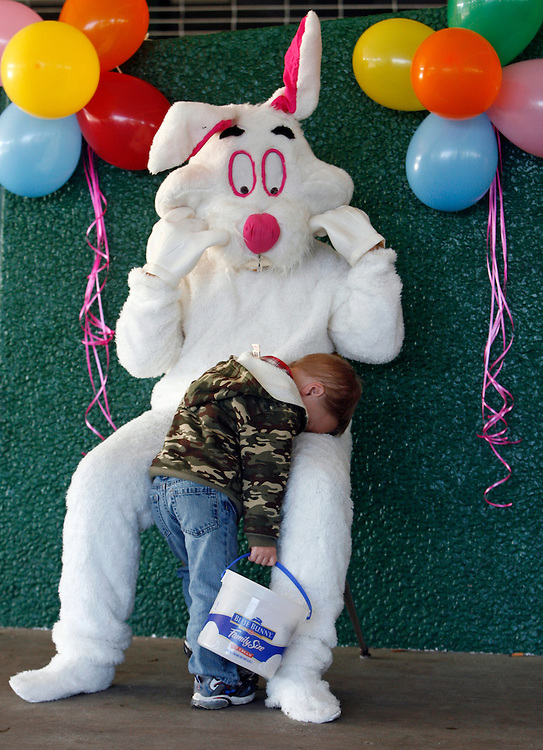 BRENDAN FITTERER  |  Times.PT_320766_FITT_easter_1 (04/02/2010 New Port Richey) With bucket in hand for the egg hunt, Kaedin Stranger, 2, of Port Richey, takes a rest on the Easter Bunny Friday morning at Gulf High School. Children gathered for an egg hunt, crafts, face painting and other activities that were part of a Relay for Life fundraiser hosted by The Gulf High School Health Careers Academy..BRENDAN FITTERER  |  Times