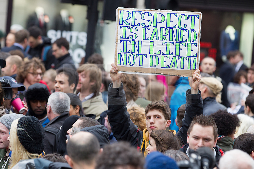 © Licensed to London News Pictures . 17/04/2013 . London , UK . A protester at Ludgate Circus . The funeral of former British Conservative Prime Minister , Baroness Margaret Thatcher , today (Wednesday 17th April 2013) in Central London . Baroness Thatcher died from a stroke at the age of 87 . Photo credit : Joel Goodman/LNP