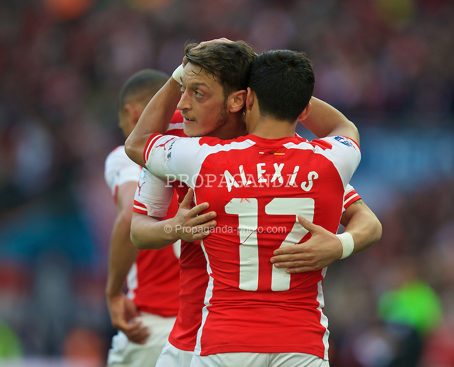 LONDON, ENGLAND - Saturday, April 18, 2015: Arsenal's Alexis Sanchez celebrates scoring the first goal against Reading with team-mate Mesut Ozil during the FA Cup Semi-Final match at Wembley Stadium. (Pic by David Rawcliffe/Propaganda)