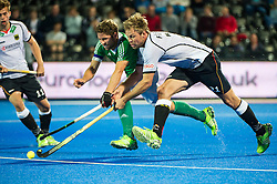 Ireland's Ronan Gormley battles for the ball with Moritz Fuerste of Germany. Ireland v Germany - Unibet EuroHockey Championships, Lee Valley Hockey & Tennis Centre, London, UK on 23 August 2015. Photo: Simon Parker