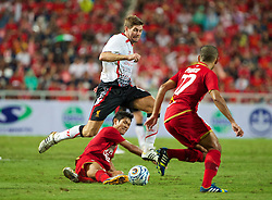 BANGKOK, THAILAND - Sunday, July 28, 2013: Liverpool's captain Steven Gerrard in action against Thailand XI during a preseason friendly match at the Rajamangala National Stadium. (Pic by David Rawcliffe/Propaganda)