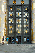 The main entrance of the Central Libary of the Brooklyn Public Library, Alfred Morton Githens and Francis Kelly, architects. The bas-reliefs beside the door are by scupltor Paul Jennwein; the screen over the entry, with its literary themes, is by Thomas H. Jones.