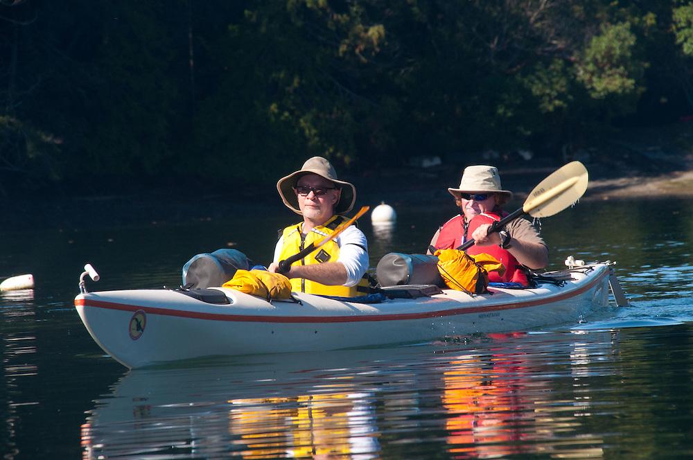 Brian and Nick Paddle out of Reid Harbor, Stuart Island, Washington, US