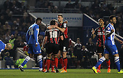 AFC Bournemouth defender Simon Francis congratulates goalscorerAFC Bournemouth striker Yann Kermorgant during the Sky Bet Championship match between Brighton and Hove Albion and Bournemouth at the American Express Community Stadium, Brighton and Hove, England on 10 April 2015. Photo by Phil Duncan.