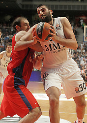 20.03.2014, Palacio de los Deportes, Madrid, ESP, Basketball EL, Real Madrid vs CSKA Moskau, Gruppe F, im Bild Real Madrid's Ioannis Bourousis (r) and CSKA Moscow's Nenad Krstic // Real Madrid's Ioannis Bourousis (r) and CSKA Moscow's Nenad Krstic during the group F Basketball Euroleague between Real Madrid and CSKA Moscow at the Palacio de los Deportes in Madrid, Spain on 2014/03/20. EXPA Pictures © 2014, PhotoCredit: EXPA/ Alterphotos/ Acero<br /> <br /> *****ATTENTION - OUT of ESP, SUI*****