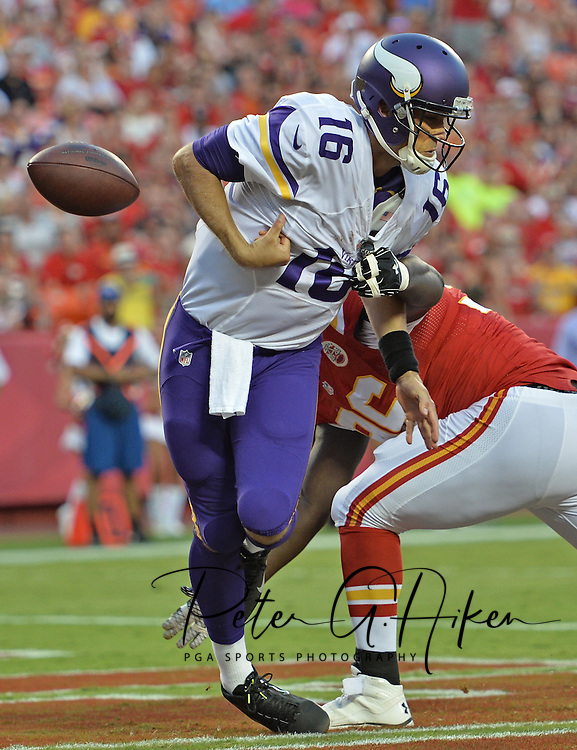 Jaye Howard #96 of the Kansas City Chiefs knocks the ball loose in the endzone for a safety against Matt Cassel #16 of the Minnesota Vikings at Arrowhead Stadium in Kansas City, Missouri.