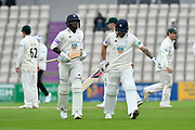Fidel Edwards of Hampshire and Gareth Berg of Hampshire leave the field after the final wicket of Fidel Edwards of Hampshire fell from the bowling of Joe Leach of Worcestershire during the Specsavers County Champ Div 1 match between Hampshire County Cricket Club and Worcestershire County Cricket Club at the Ageas Bowl, Southampton, United Kingdom on 13 April 2018. Picture by Graham Hunt.