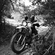Steve Christiansen powers up a gully along the Ho Chi Minh Trail in Laos.