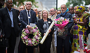 UNITED KINGDOM, London: 7 July 2015 Friends and family of the victims of the July the 7th bombing in London mourn and pay there respects including the driver of the number 30 bus George Psaradakis (2nd R) that day at the spot where the number 30 bus was attacked on the ten year anniversary at Tavistock Square in London, England. Andrew Cowie / Story Picture Agency
