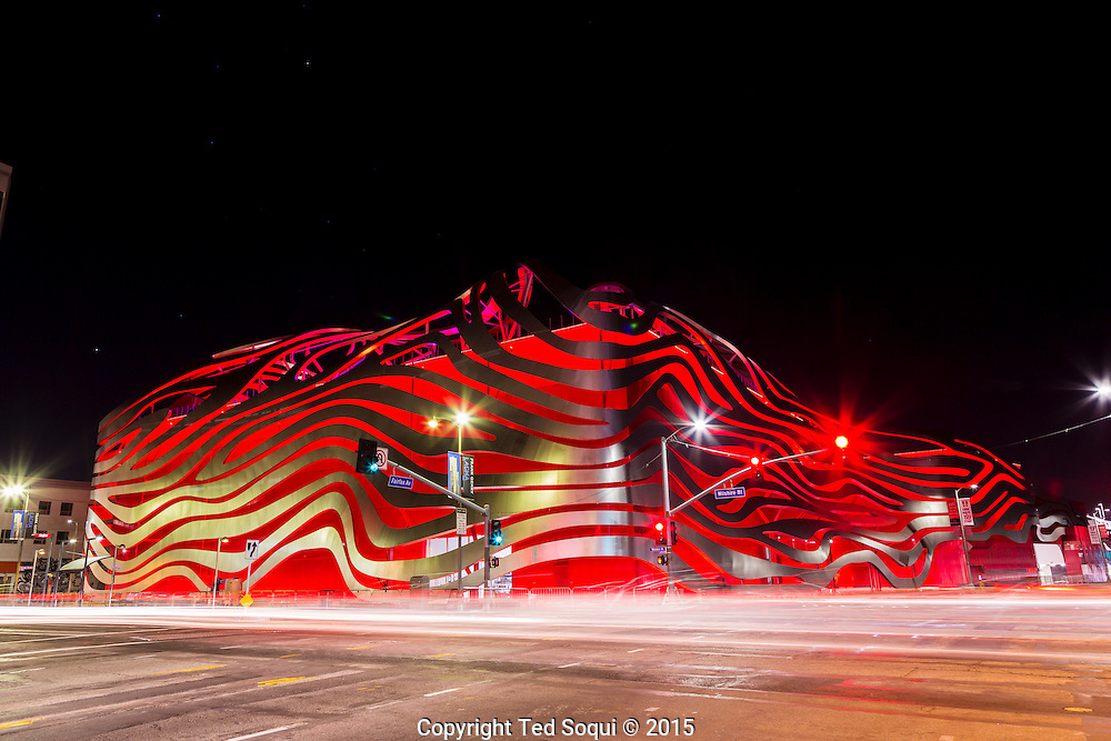 The Petersen Automotive Museum underwent a 14 month facelift and is now re-opened. The new exterior includes bended and curvy stainless steel stripes. There is new lighting for the exterior. <br /> The new 95,000square foot, three floor museum will feature cars from all over the world in 25 separate galleries.