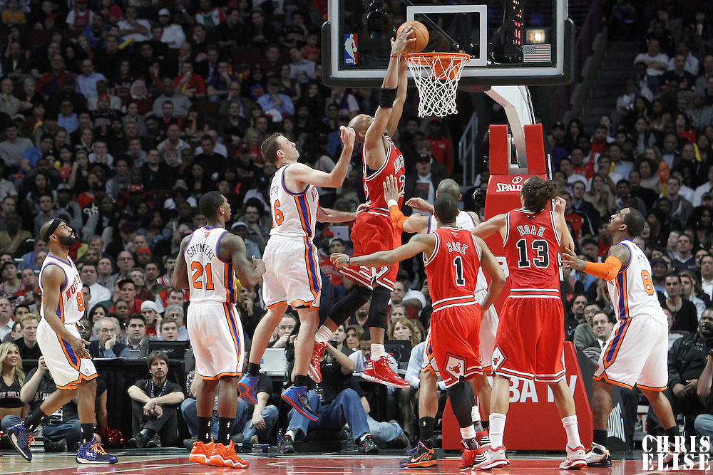 12 March 2012: Chicago Bulls forward Taj Gibson (22) dunks the ball during the Chicago Bulls 104-99 victory over the New York Knicks at the United Center, Chicago, Illinois, USA.