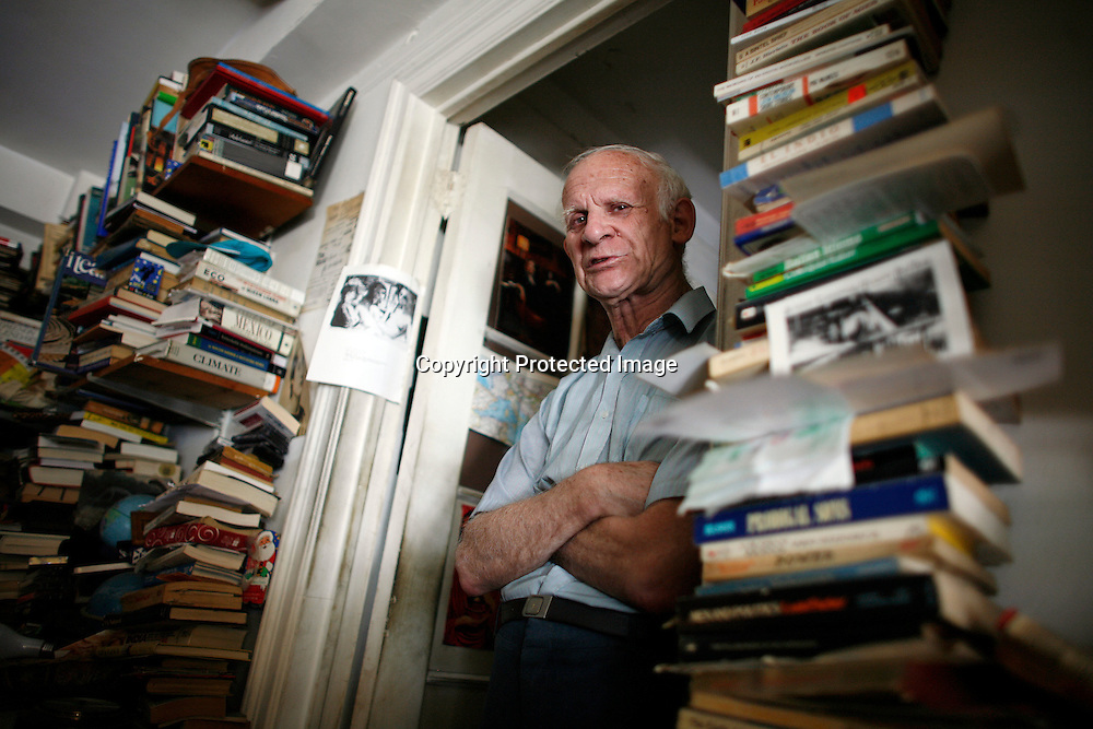 Steven Fybish sits in his apartment in New York, August 20, 2008. Fybish was facing eviction for having an overcrowded apartment. Photo by Keith Bedford for The New York Times