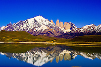The Towers of Paine (gigantic granite monoliths) and the Cuernos del Paine Mountains reflecting into the Bitter Lagoon (Laguna Amarga), Torres del Paine National Park, Patagonia, Chile