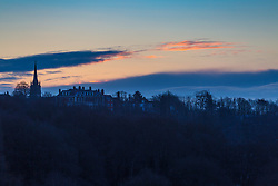 """The rising sun illuminates distant clouds. The threatened snow from """"The Beast From The East"""" weather system doesn't materialise overnight in London leaving a crisp, clear morning, seen from Hampstead Heath in North London. London, February 27 2018."""