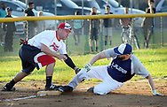 Real Ponce third baseman Antonio Ruiz attempts to tag out Lajas Frankie Crespo during a semifinal playoff softball game in a league consisting of teams named after Puerto Rican cities Thursday, September 07, 2017 in Bristol, Pennsylvania. The teams in the league are named after various towns and areas in Puerto Rico, including Lajas, Real Ponce, Adjuntas and Comerio. (Photo by William Thomas Cain)