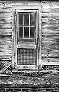 Front door of a small abandoned house on Old Greensboro Road near High Point, NC.