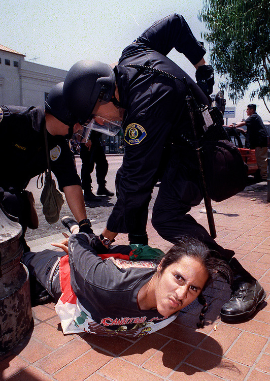 Riot police subdue one of about a dozen people arrested in a rock-and-bottle throwing incident Monday, June 29, 1998 in Huntington Park, Calif., after Germany defeated Mexico in World Cup soccer. The 2-1 loss and hundreds of officers in riot gear blockading downtown deterred a repeat of widespread soccer rowdiness that occurred last week.