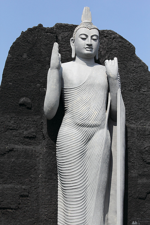 A modern standing Buddha statue, near the ruins complex at Polunnaruwa, part of Sri Lanka's Cultural Triangle