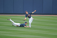 Ole Miss' Will Jamison (4) makes a catch as center fielder Auston Bousfield (9) dives for the ball vs. Lipscomb at Oxford-University Stadium in Oxford, Miss. on Saturday, March 9, 2013. Ole Miss won 8-5. The win was the 486th for Mike Bianco as the Rebel head coach, making him the university's all time winningest baseball coach.