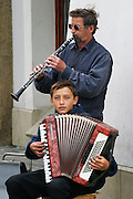 Krakow, Poland musicians in old town square playing for money.