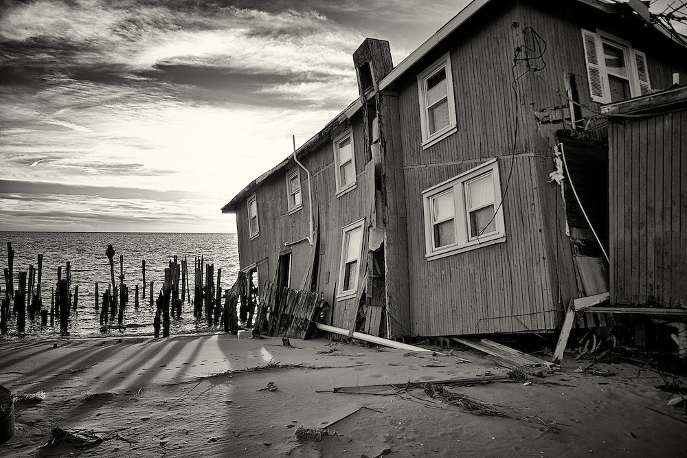 House in Fortescue falls into the sea after permanent damage from hurricane Sandy.<br />Fortescue, also known as the &quot;weakfish capital of the world&quot; was severely damaged by the hurricane with many households suffering structural damage. Without state aid, its residents have been forced to leave and is now a ghost town, with most of its properties for sale.