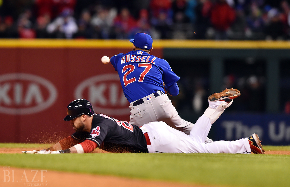 Oct 26, 2016; Cleveland, OH, USA; Cleveland Indians second baseman Jason Kipnis (22) slides into second base with a double as Chicago Cubs shortstop Addison Russell catches the ball in the 6th inning in game two of the 2016 World Series at Progressive Field. Mandatory Credit: Ken Blaze-USA TODAY Sports
