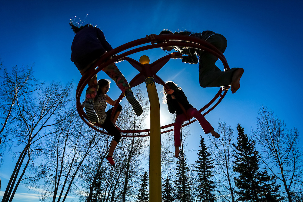 Children enjoy the spring weather at Rotary Peace Park in Whitehorse.
