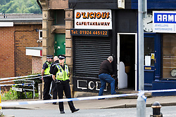 © Licensed to London News Pictures. 16/06/2016. Leeds, UK. Police attend the scene in Birstall, south of Leeds, where Jo Cox, Member of Parliament for Batley and Spen, has been shot and stabbed during a constituency surgery. Photo credit: Andrew McCaren/LNP