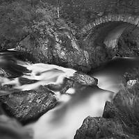 Water running under an old bridge
