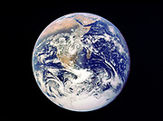 Whole Earth from space - view from Apollo 17 December 1972. First photograph of south polar ice cap. Most of Africa visible also Arabian Peninsular and Madagascar (Malagasy). NASA photograph.