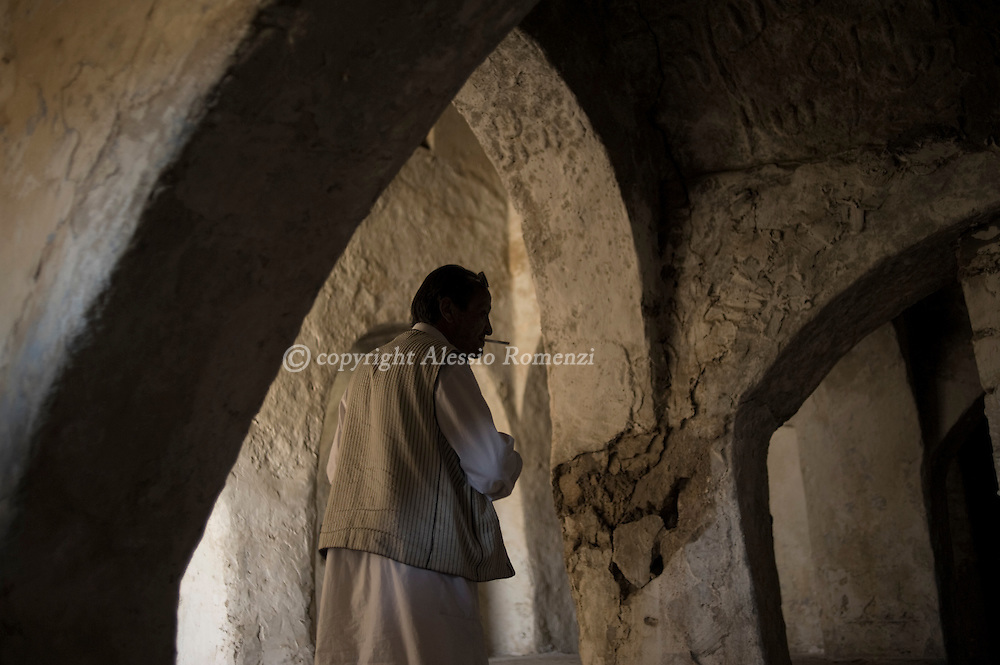 LIBYAN ARAB JAMAHIRIYA, YEFREN : Libyan man, stands inside one of the surviving synagogues in the Berber village of Yefren in western Libya on July 13, 2011. Once a thriving community perfectly integrated in the wider Berber tribe, the Jews of Yefren had to leave their belongings behind in the wake of the Arab-Israeli war in 1948 and have since then been expelled from the Libyan soil by the embattled leader Moamer Kadhafi. ALESSIO ROMENZI