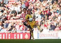 Photo: Andrew Unwin.<br />Sunderland v Barnsley. Coca Cola Championship. 21/10/2006.<br />Barnsley's Brian Howard (R) is put under pressure by Sunderland's Dean Whitehead (L).