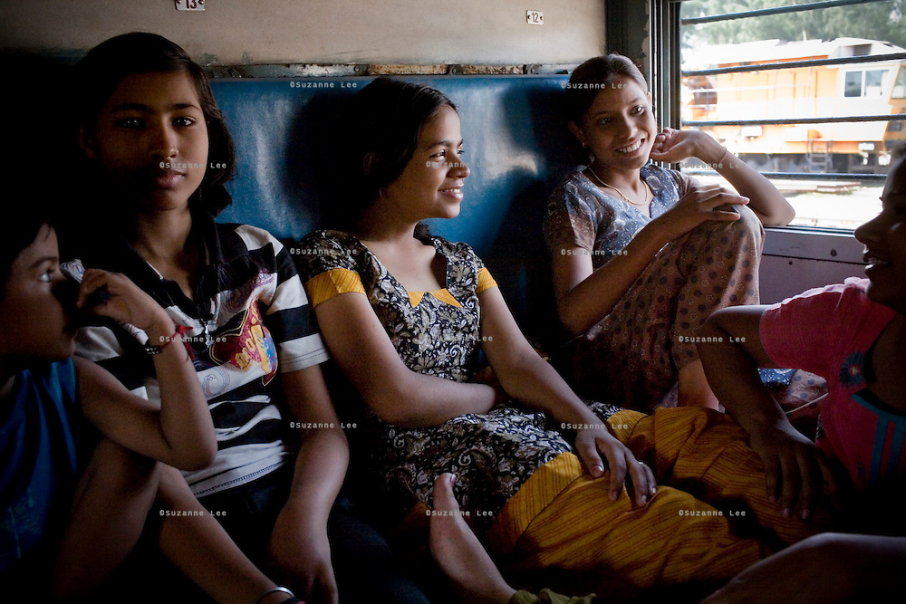 Young girls chat amongst themselves while rumbling through Punjab aboard the Himsagar Express 6318 on 7th July 2009.. .6318 / Himsagar Express, India's longest single train journey, spanning 3720 kms, going from the mountains (Hima) to the seas (Sagar), from Jammu and Kashmir state of the Indian Himalayas to Kanyakumari, which is the southern most tip of India...Photo by Suzanne Lee / for The National