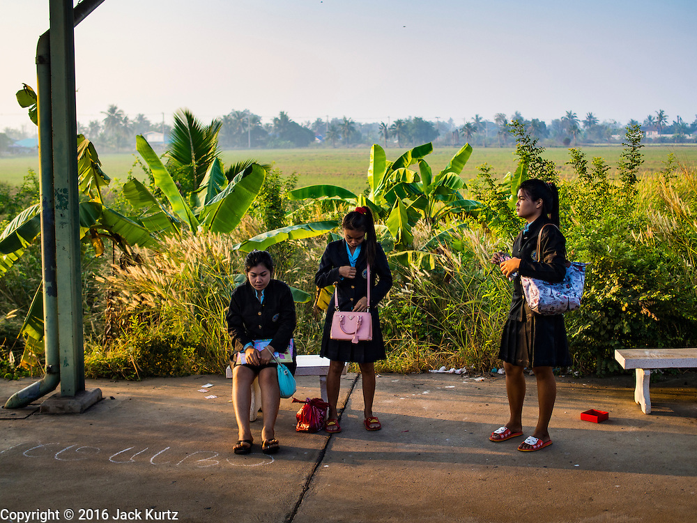 14 JANUARY 2016 - CHACHOENGSAO, CHACHOENGSAO, THAILAND:  Women wait for a Bangkok bound train in a small station in Chachoengsao province, east of Bangkok.         PHOTO BY JACK KURTZ
