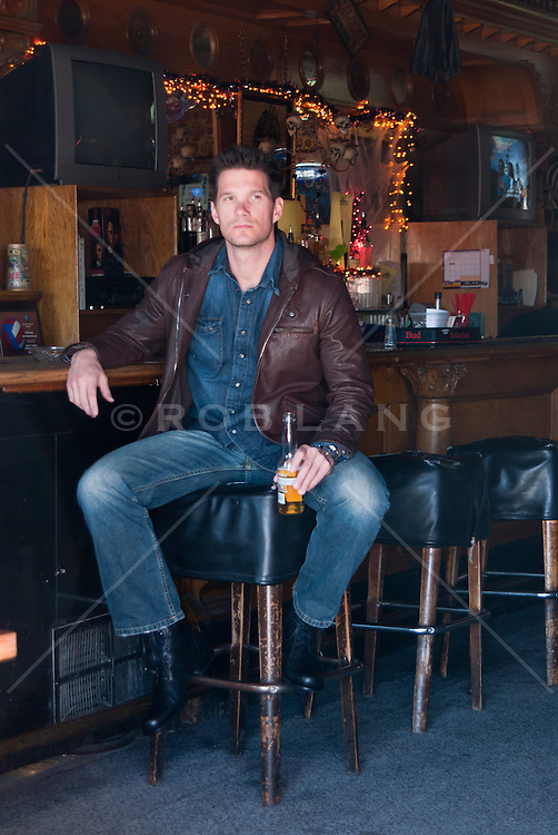 all american man sitting in a bar