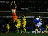 Leeds keeper Graham Stack safely gathers a cross