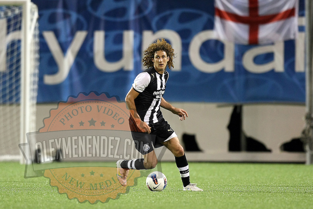 Newcastle United Defender Fabricio Coloccini kicks the ball during an International Friendly soccer match between English Premier League team Newcastle United and the Orlando City Lions of the United Soccer League, at the Florida Citrus Bowl on Saturday, July 23, 2011 in Orlando, Florida. Orlando won the match 1-0. (AP Photo/Alex Menendez)