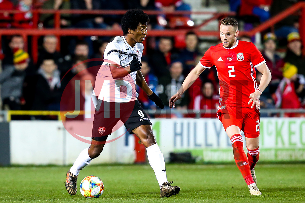 Nathan Lewis of Trinidad and Tobago takes on Chris Gunter of Wales - Mandatory by-line: Robbie Stephenson/JMP - 20/03/2019 - FOOTBALL - The Racecourse Ground - Wrexham, United Kingdom - Wales v Trinidad and Tobago - International Challenge Match