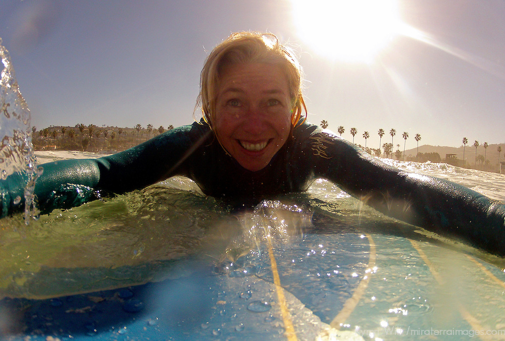USA, California, La Jolla. Woman on surfboard at La Jolla Shores.